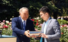 Leader of Nation Nursultan Nazarbayev puts the time capsule with message to future generation